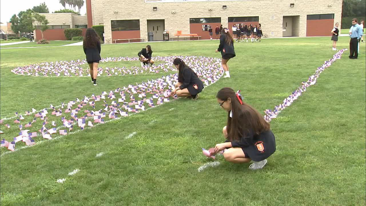Students at Saint Joseph High School in Lakewood placed flags in the campus lawn to honor those killed in the Sept. 11, 2001, terror attacks.