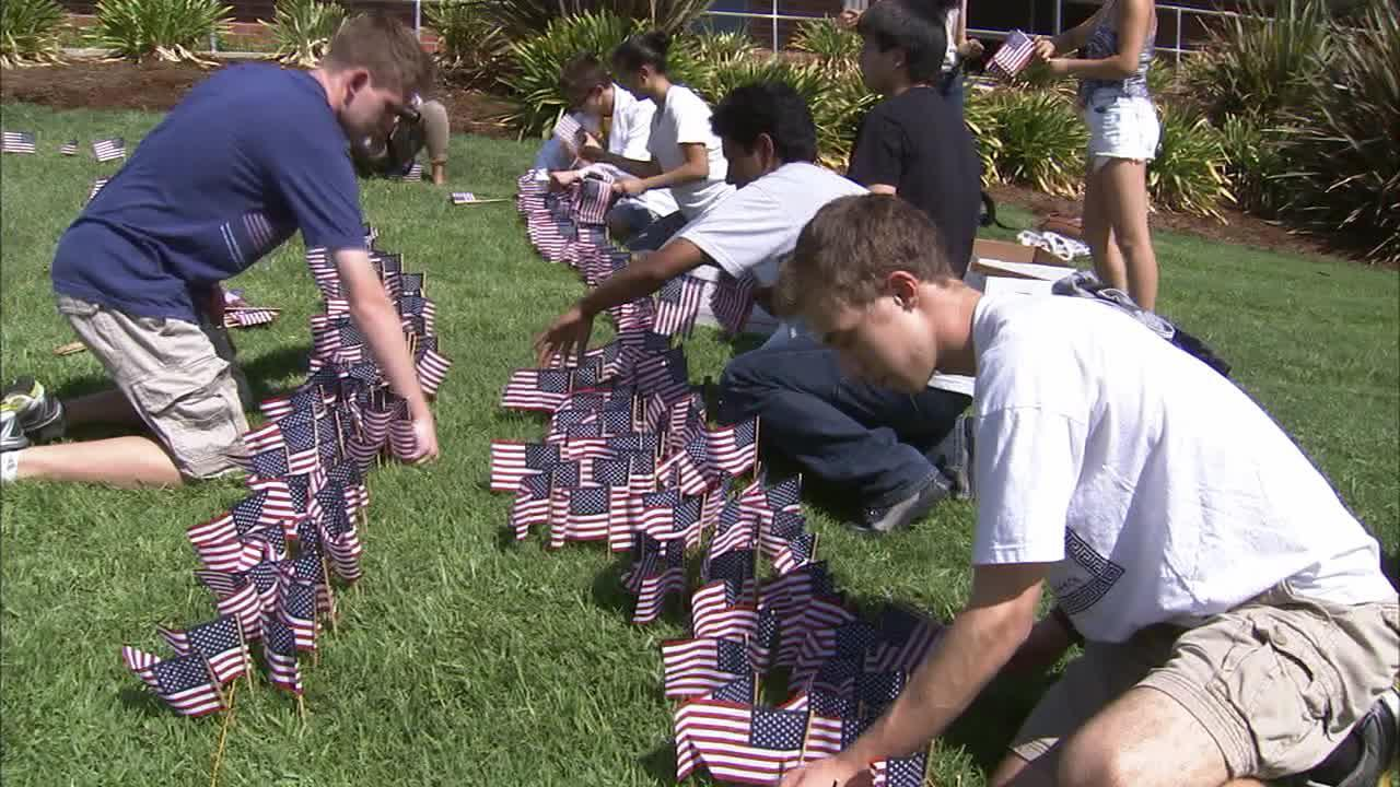 Students at Walnut High School placed nearly 3,000 flags in front lawn of their campus in honor of those killed on Sept. 11, 2001.Wednesday marked the 12th anniversary of the 9/11 terrorist attacks.