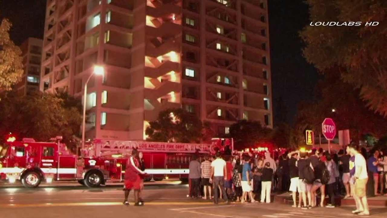 A trash bin fire at Webb Hall, a 15-story USC dormitory, sent hundreds of students into the streets Friday, Sept. 13, 2013.