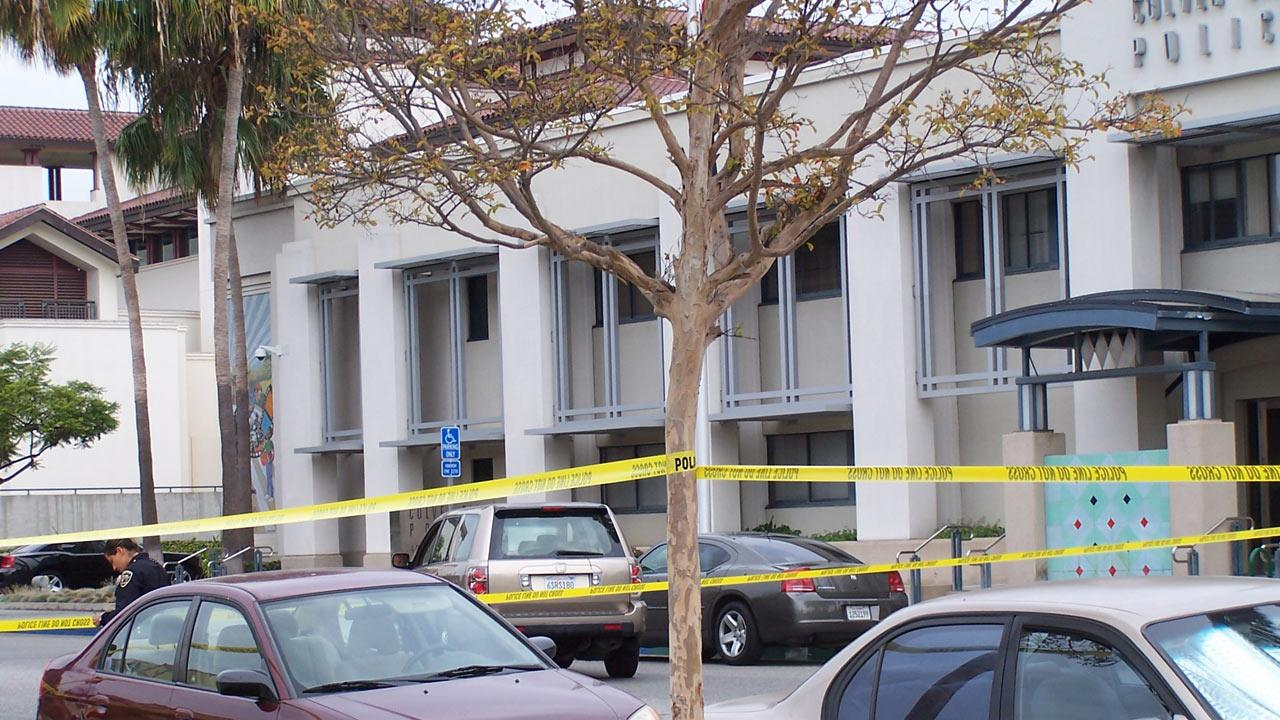 In this photo from an ABC7 viewer, police investigate a fatal officer-involved shooting in the parking lot of the Culver City Police Department headquarters on Saturday, Sept. 21, 2013.