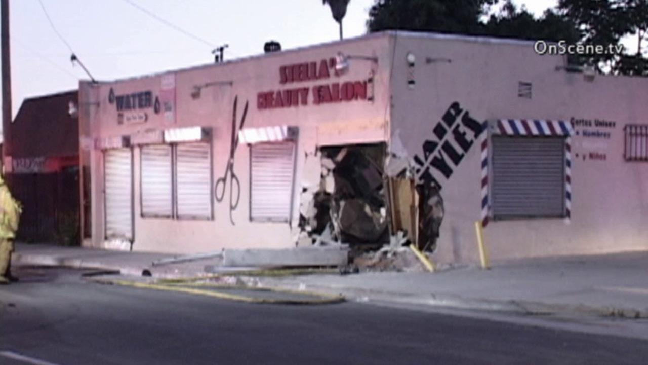 A silver sedan slammed into a Lexus with two women inside before crashing into a beauty salon in Compton Sunday, Sept. 23, 2013.