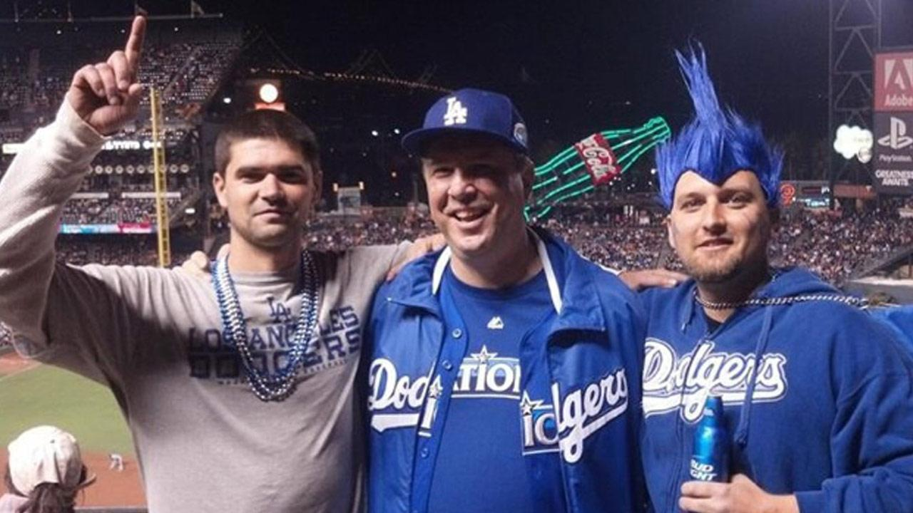Jonathan Denver, left, poses for a photo with his father, Robert Preece, and his brother at the AT&T Park in San Francisco on Wednesday, Sept. 25, 2013. He was stabbed to death later that night in a fight over the Giants-Dodger rivalry.