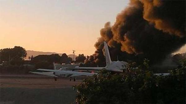 Smoke is seen following a small plane crash at Santa Monica Airport in the 3000 block