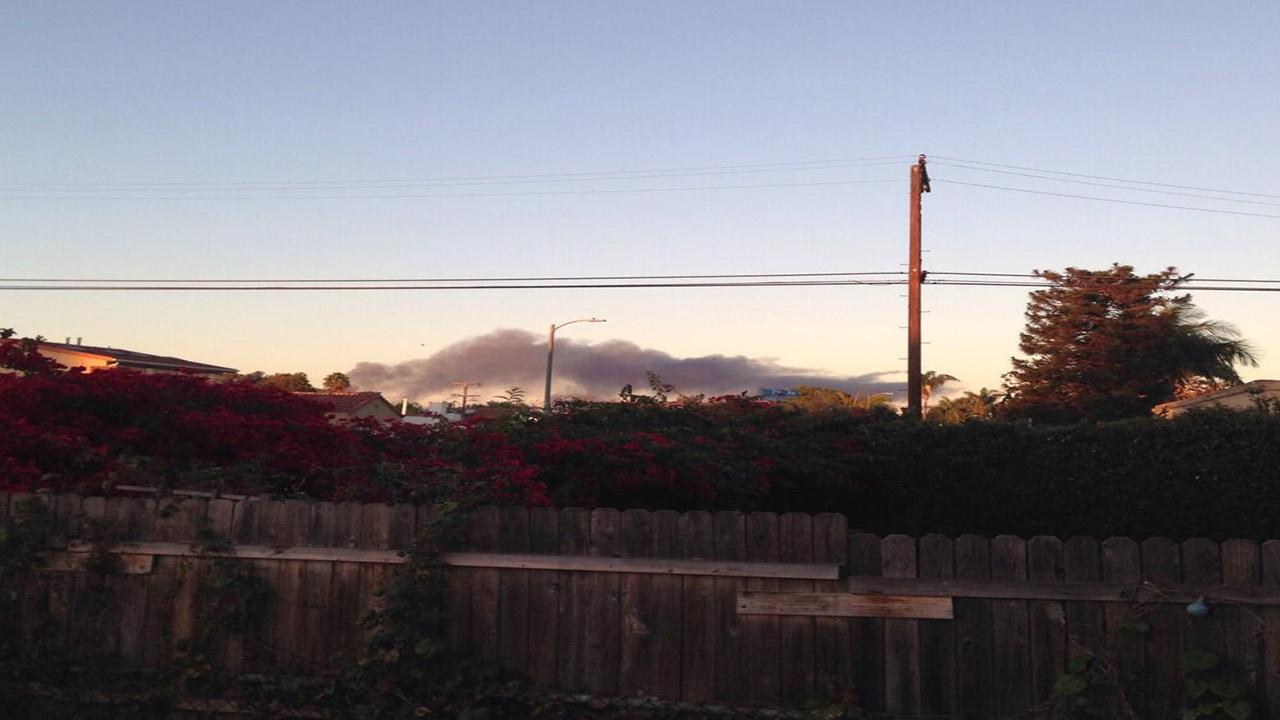 Smoke is seen after a small plane crashed at Santa Monica Airport on Sunday, Sept. 29, 2013. <span class=meta>(Twitter &#47; Carina Kolodny)</span>