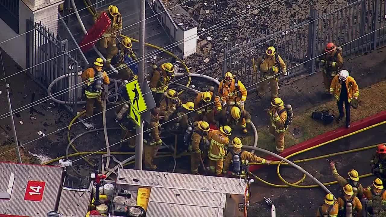 A firefighter is rescued from a burning church in Los Angeles on Tuesday, Oct. 8, 2013.