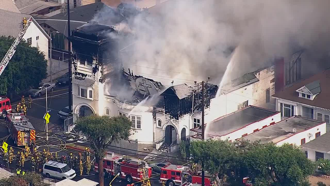 Firefighters battle a fire at a historic church in Los Angeles on Tuesday, Oct. 8, 2013.