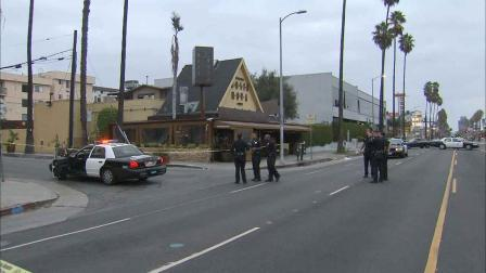 Police respond to the scene of a shooting following an altercation outside of Bossa Nova near Formosa Avenue and Sunset Boulevard in Hollywood Sunday, Oct. 13, 2013.