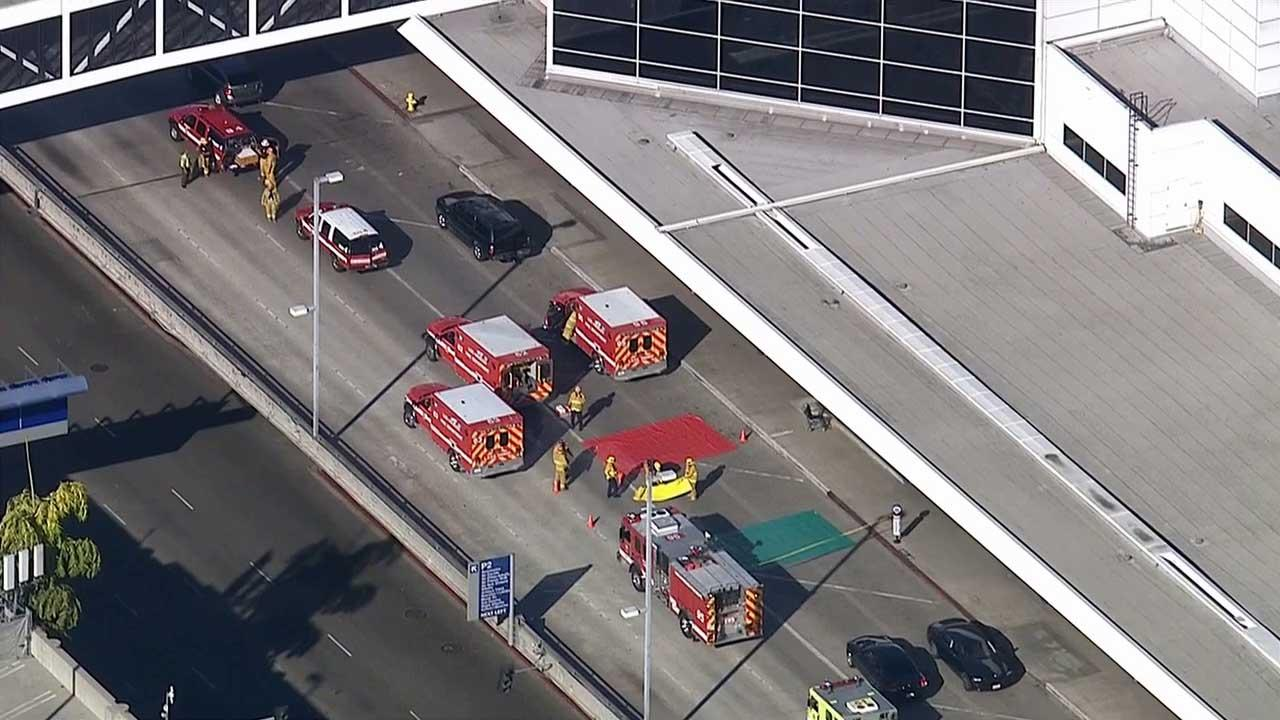 Authorities investigate a shooting at LAX Terminal 3 in Los Angeles on Friday, Nov. 1, 2013.