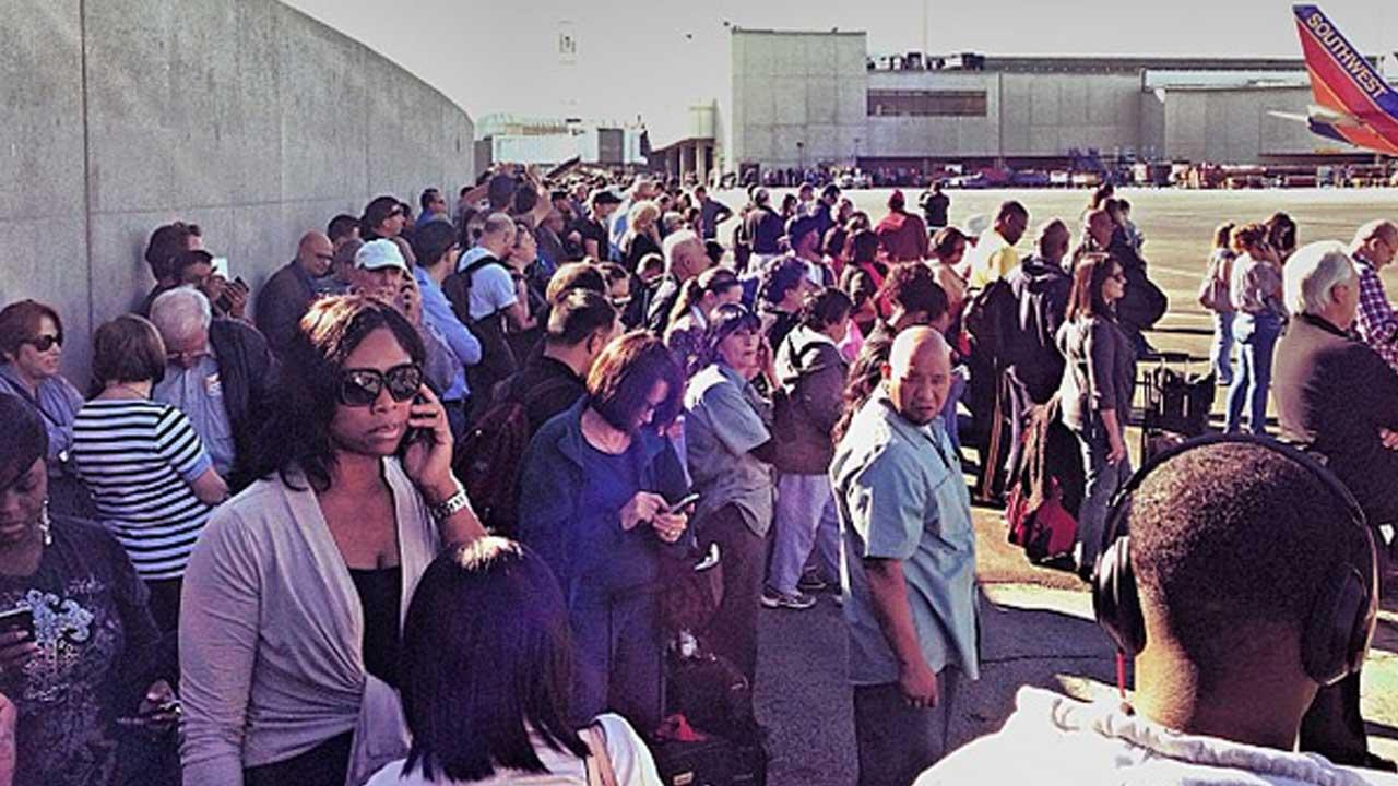 Authorities investigate a shooting at LAX Terminal 3 in Los Angeles on Friday, Nov. 1, 2013.Photo via instagram.com/kgstoney