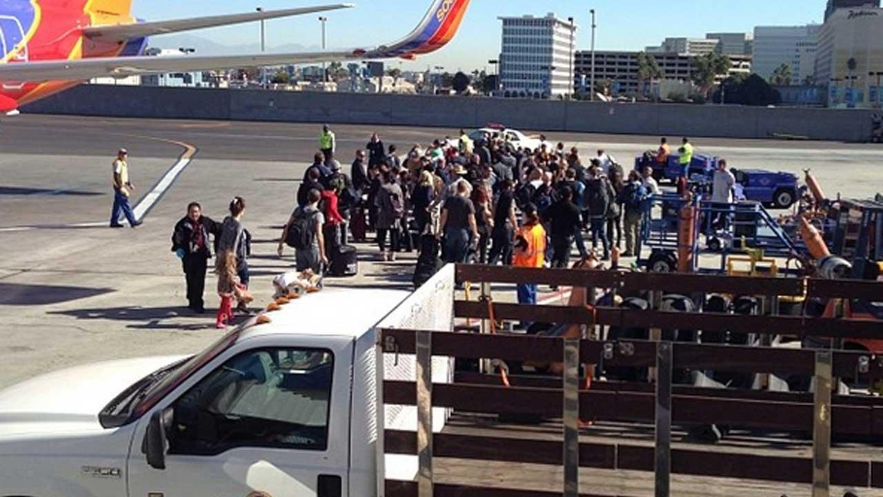 Authorities investigate a shooting at LAX Terminal 3 in Los Angeles on Friday, Nov. 1, 2013. <span class=meta>(Photo via instagram.com&#47;ruffdraftj12)</span>