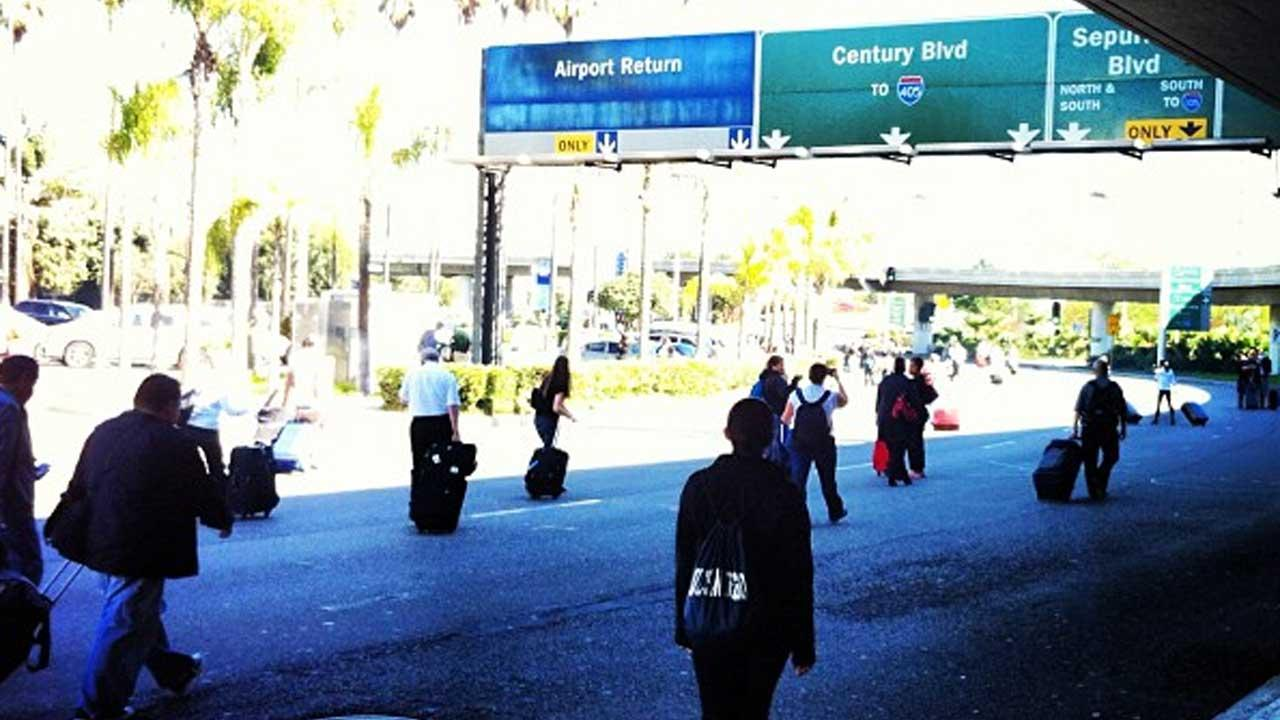 Authorities investigate a shooting at LAX Terminal 3 in Los Angeles on Friday, Nov. 1, 2013. <span class=meta>(Photo via instagram.com&#47;310slugger)</span>