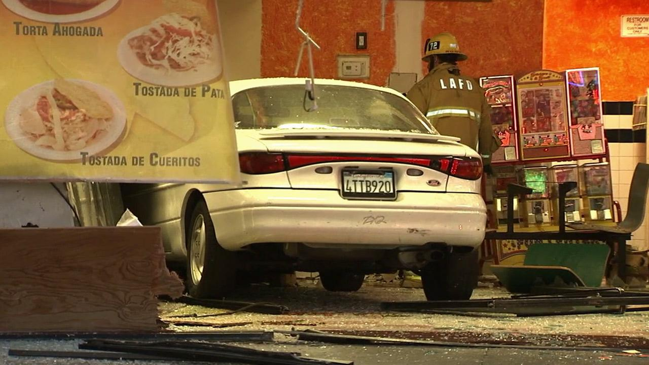 An elderly man crashed his car into the El Taco Llama restaurant at Topanga Canyon Boulevard and Saticoy Street in Canoga Park on Saturday, Nov. 2, 2013.