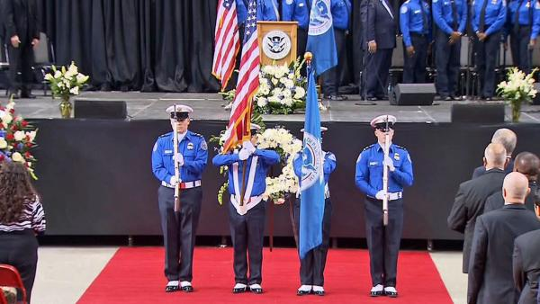 A flag ceremony is held during the public memorial in honor of murdered TSA Officer Gerardo Hernandez on Tuesday, Nov. 12, 2013.