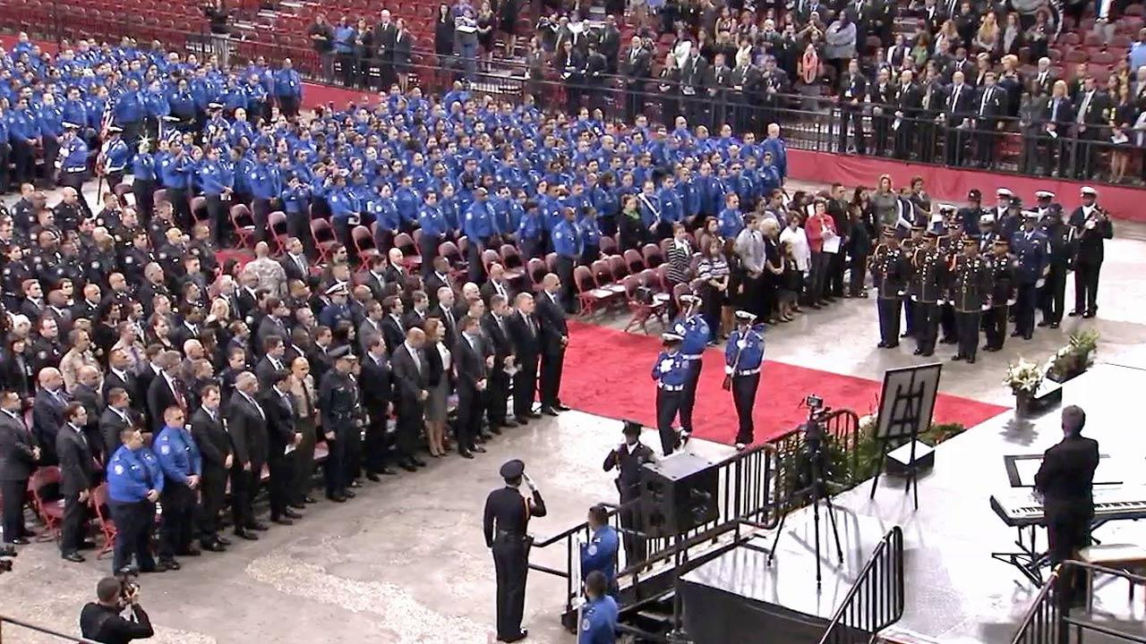 The Honor Guard steps up to the podium during the public memorial in honor of murdered TSA Officer Gerardo Hernandez on Tuesday, Nov. 12, 2013.