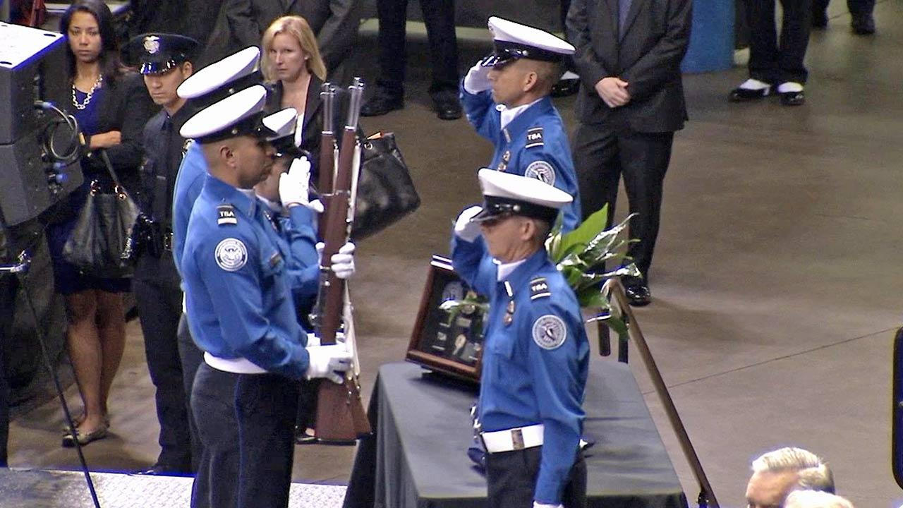 The Honor Guard salutes during the public memorial in honor of murdered TSA Officer Gerardo Hernandez on Tuesday, Nov. 12, 2013.