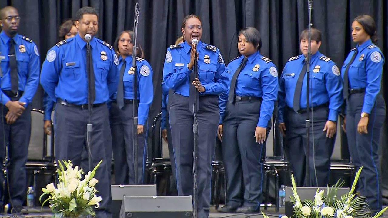 A choir sings during the public memorial in honor of murdered TSA Officer Gerardo Hernandez on Tuesday, Nov. 12, 2013.