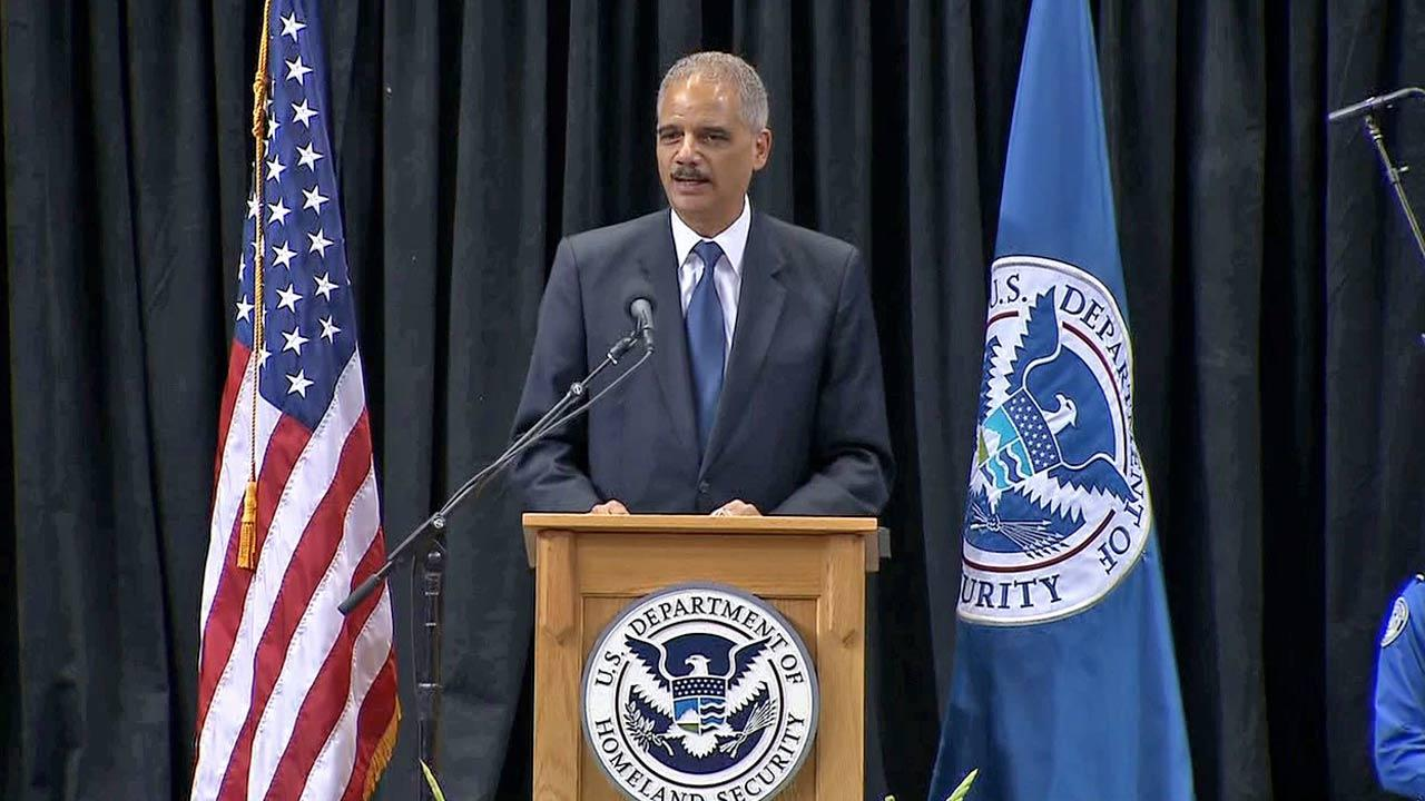 U.S. Attorney General Eric Holder speaks at the public memorial service for TSA officer Gerardo Hernandez on Tuesday, Nov. 12, 2013.