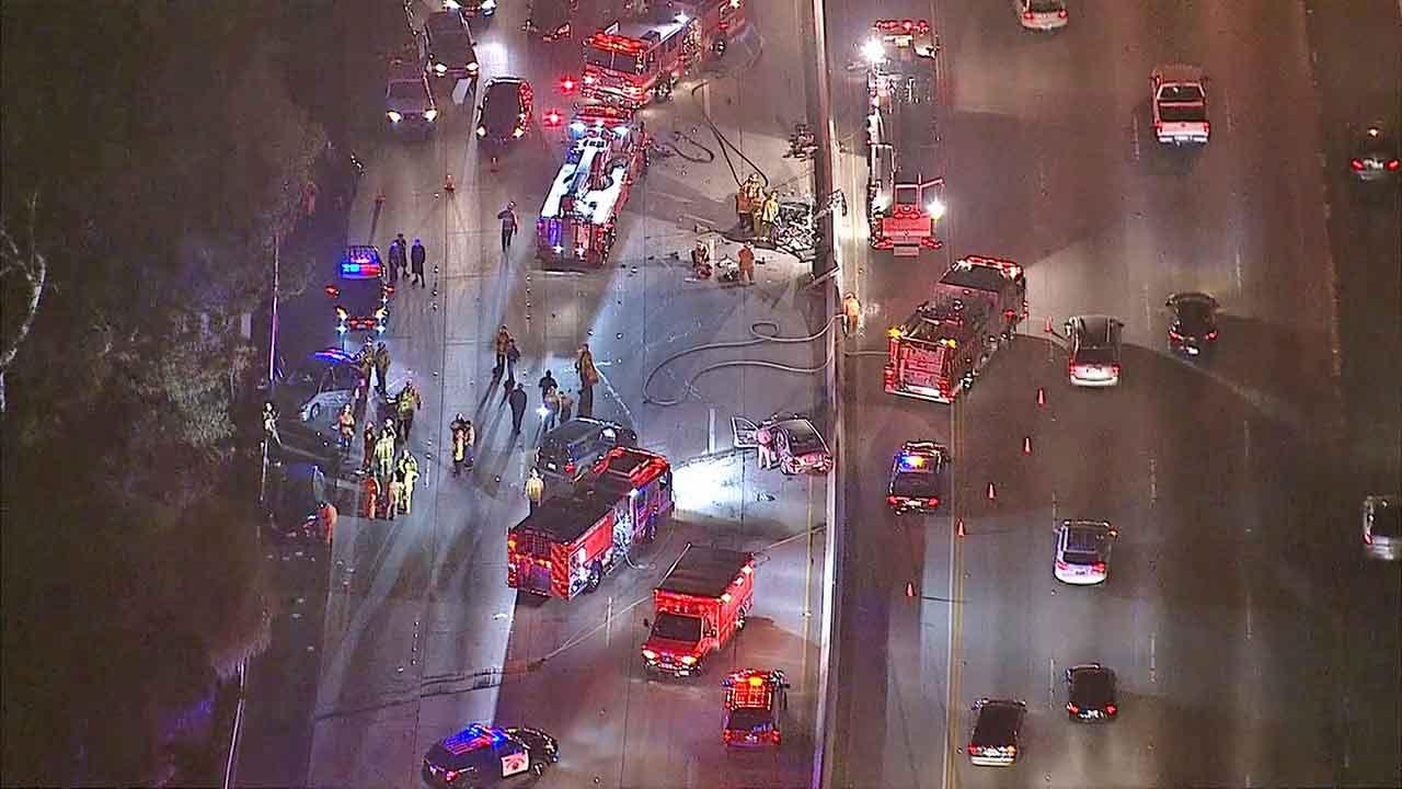 Authorities respond to the scene of a five-vehicle collision on the southbound 170 Freeway near Oxnard Street in North Hollywood, Friday, Nov. 15, 2013.