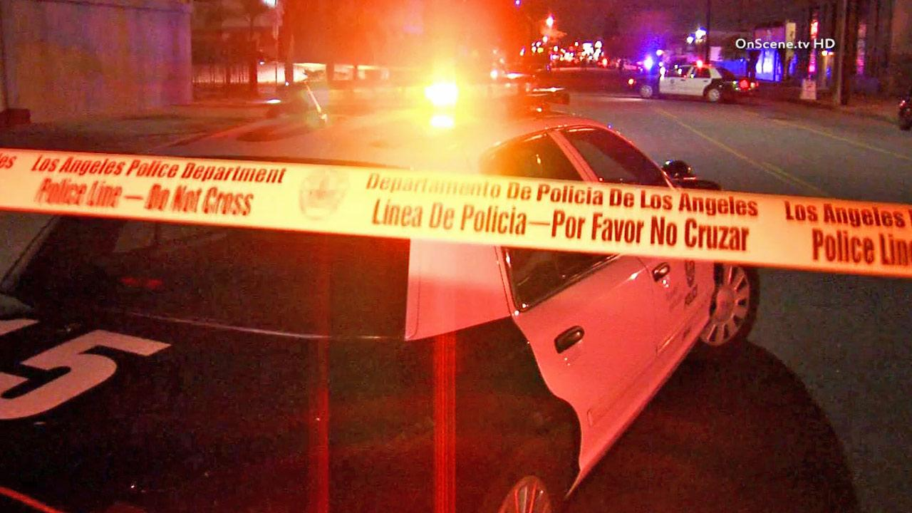 Crime tape ropes off the scene of a fatal officer-involved shooting in North Hollywood on Friday, Nov. 22, 2013.