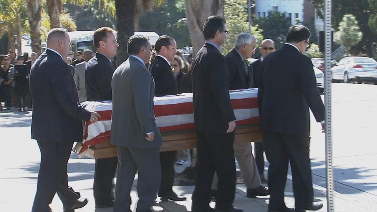 Hundreds of people, including city leaders, attended funeral services for Joseph Gatto at Our Mother of Good Counsel Church on November 25, 2013.