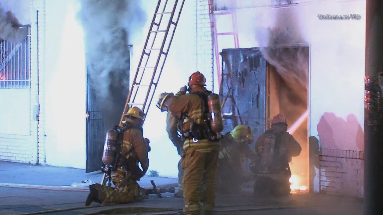 A fire ripped through a commercial building on South Figueroa Street in South Los Angeles on Friday, Nov. 29, 2013.