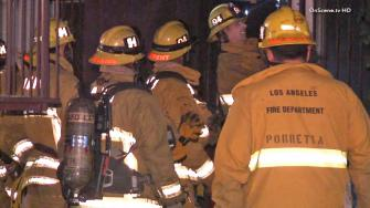 Firefighters are shown at the scene of a fatal apartment fire in Baldwin Village on Wednesday, Dec. 4, 2013.