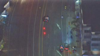 An LAPD motorcycle officer was struck by a hit-and-run driver at Sunset and PCH Wednesday night, Dec. 4, 2013.