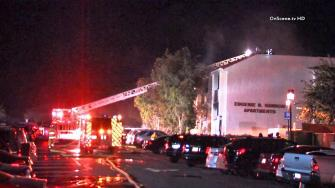 Firefighters respond to a dormitory fire at Loyola Marymount University in Westchester on Saturday, Dec. 7, 2013.