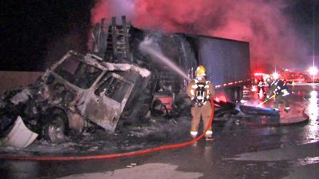 A big-rig crash and resulting fire closed down all westbound lanes of the 210 Freeway on Tuesday, Dec. 17, 2013.