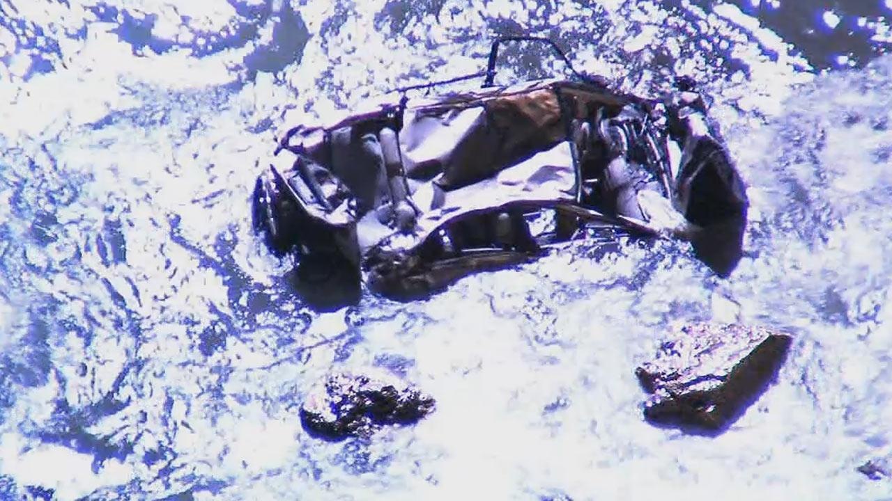 One person had to be rescued after a car went off a cliff and plunged into the ocean in Palos Verdes on Friday, Dec. 27, 2013.