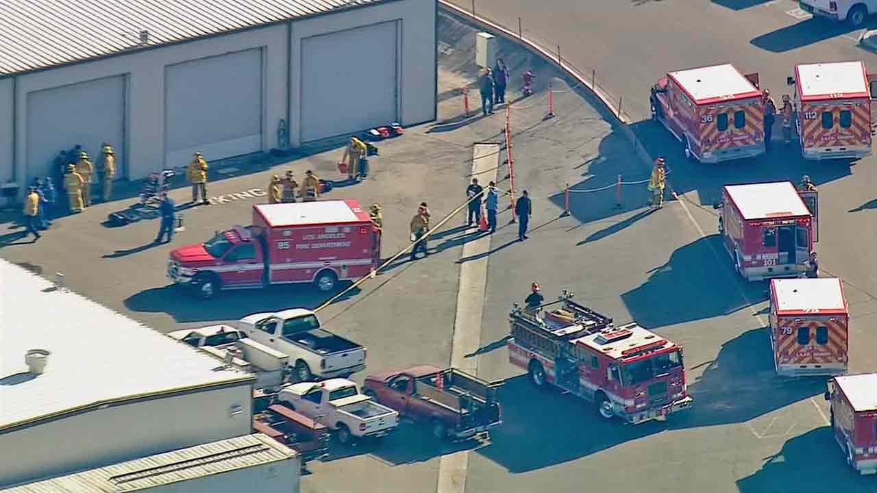 Firefighters respond to the scene of a hazmat situation at the Phillips 66 refinery on the 1660 block of West Anaheim Street in Wilmington Tuesday, Dec. 31, 2013.