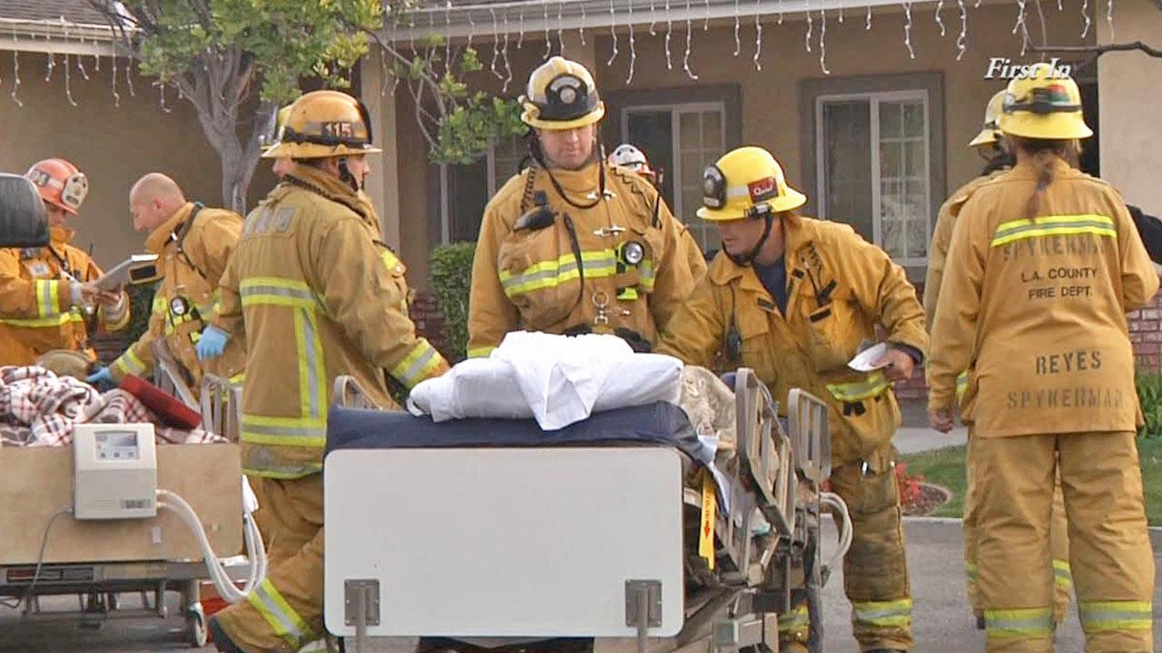 Firefighters are shown at the scene of a fire at an assisted living home in the 17700 block of Gridley Road in Artesia on Saturday, Jan. 4, 2014.