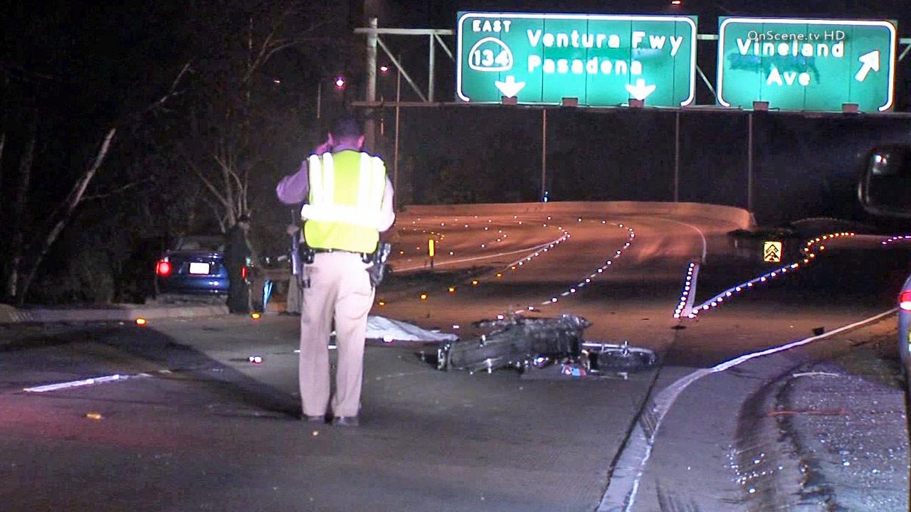A law enforcement official investigates the scene of a fatal crash on the eastbound 101 Freeway transition to the eastbound 134 Freeway on Saturday, Jan. 11, 2014.