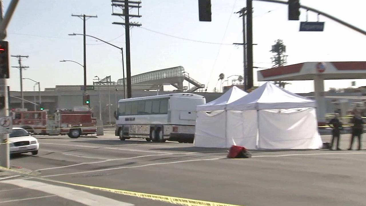 Authorities investigate an accident involving a tour bus that hit and killed a pedestrian in South L.A. on Saturday, Jan. 11, 2014.