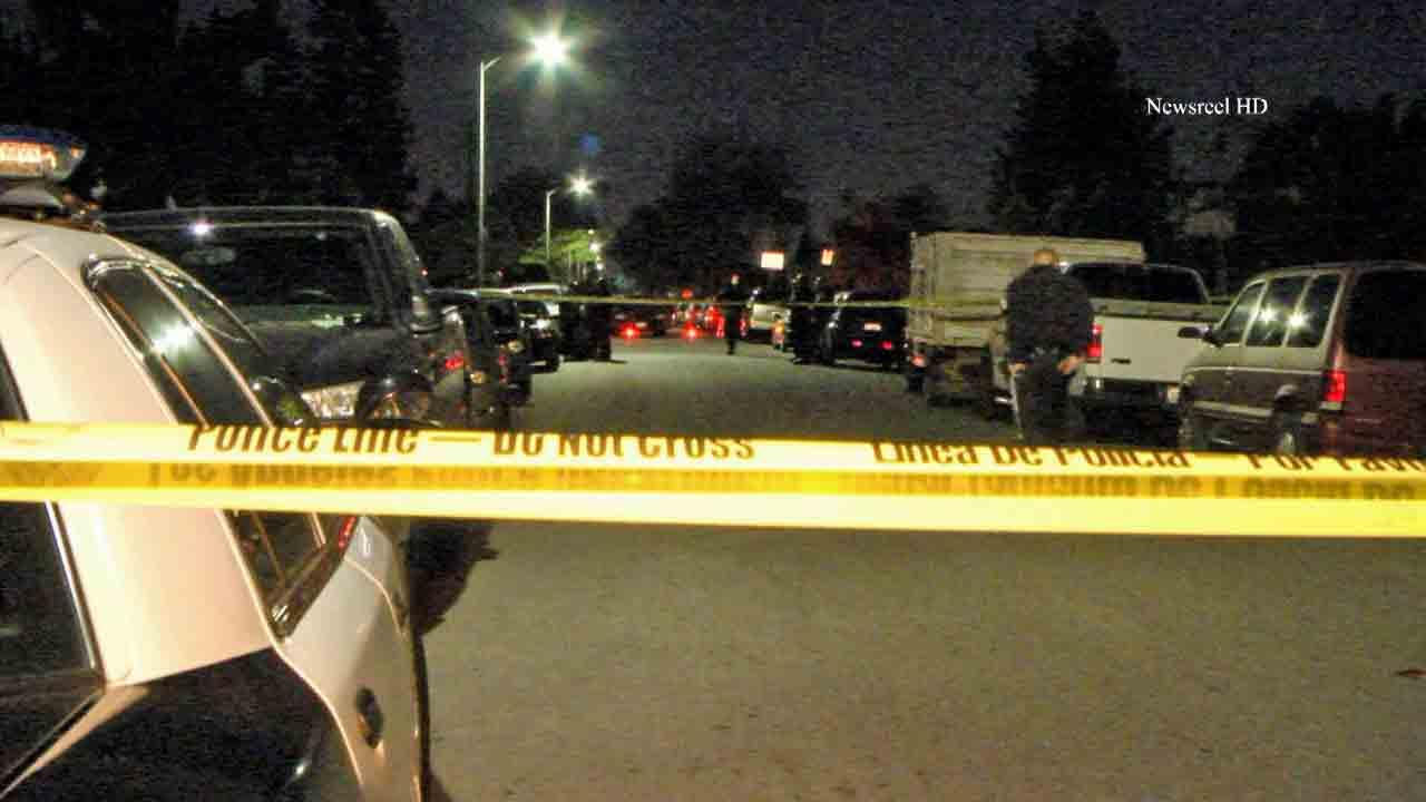 Police respond to the scene of a fatal shooting on the East 76th Place in South Los Angeles Monday, Jan. 13, 2014.