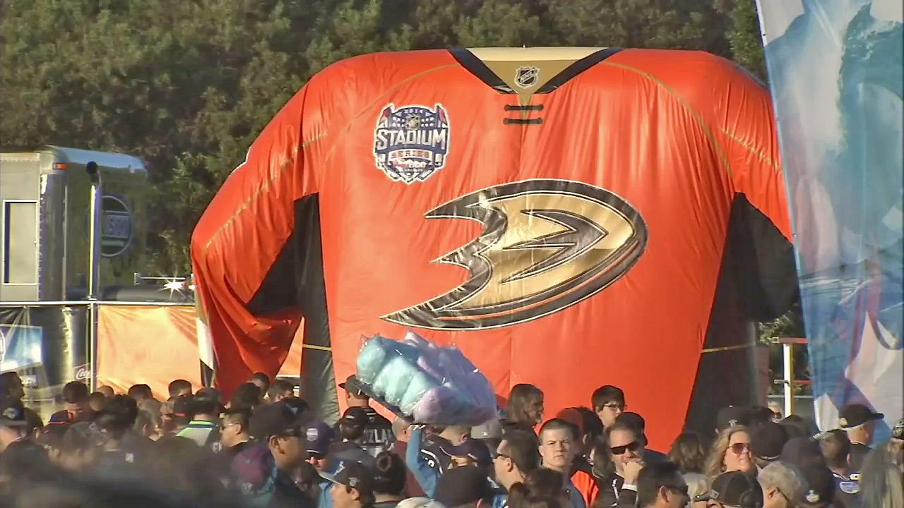 A giant inflatable Anaheim Ducks jersey towers over hockey fans at Dodger Stadium for the Stadium Series against the Anaheim Ducks on Saturday, Jan. 25, 2014.