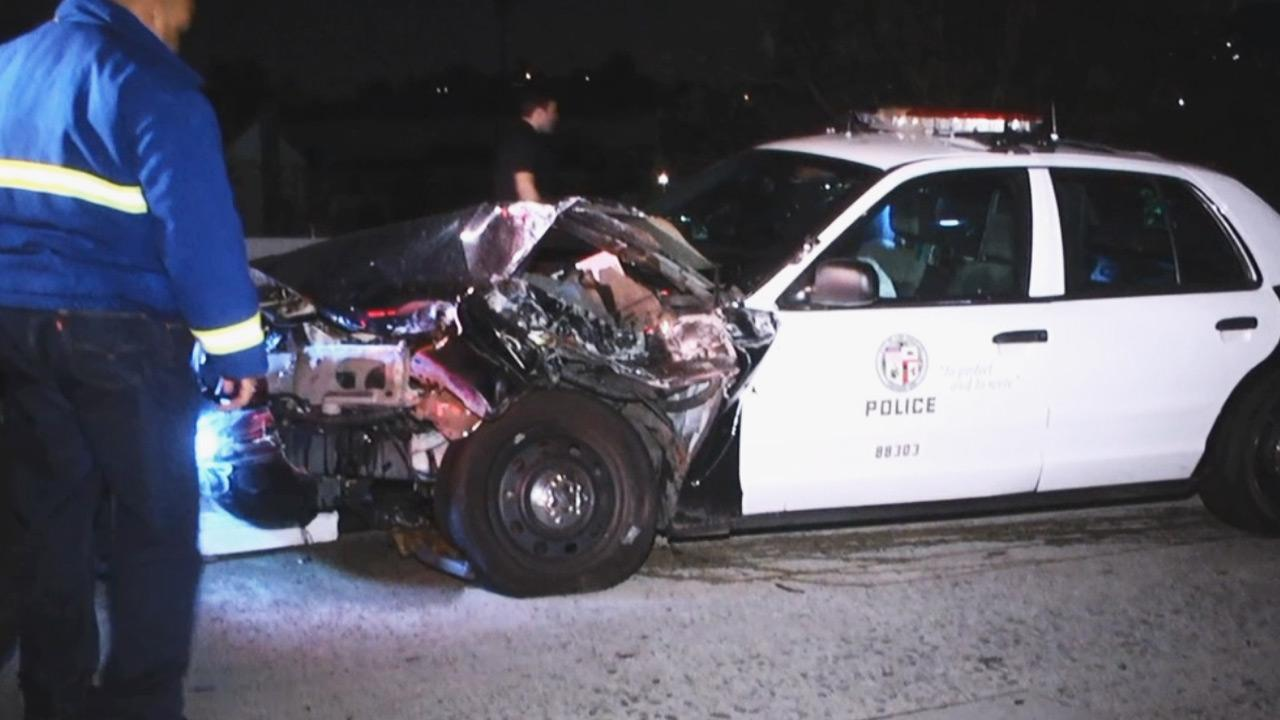 An LAPD officer was hospitalized after crashing into a car on the 2 Freeway in Eagle Rock early Monday morning.