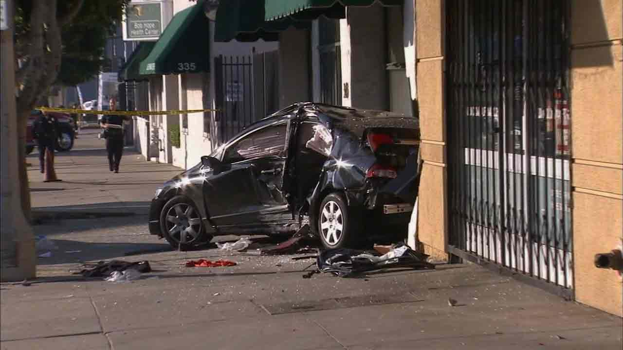 Two people were injured when a car slammed into a building on the 300 block of North La Brea in the Park La Brea area of Los Angeles Sunday, Feb. 23, 2014.