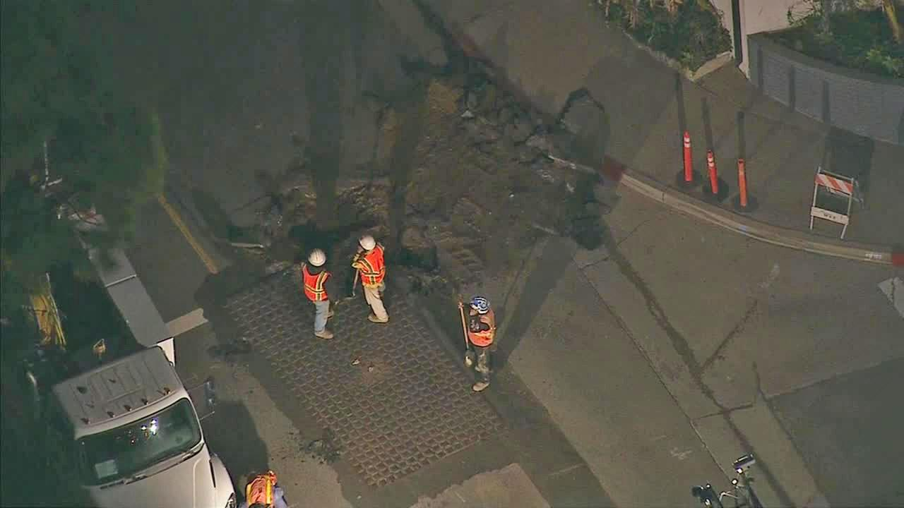 Crews are seen fixing a broken gas line in Baldwin Hills on Friday, March 7, 2014.