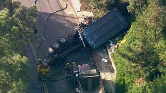 An LAPD patrol car was involved in a crash with a trash truck in Beverly Hills Friday morning.