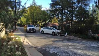 Authorities respond to the scene of a crash and bee attack on the 2000 block of Los Amigos Street in La Canada Flintridge Sunday, March 9, 2014.