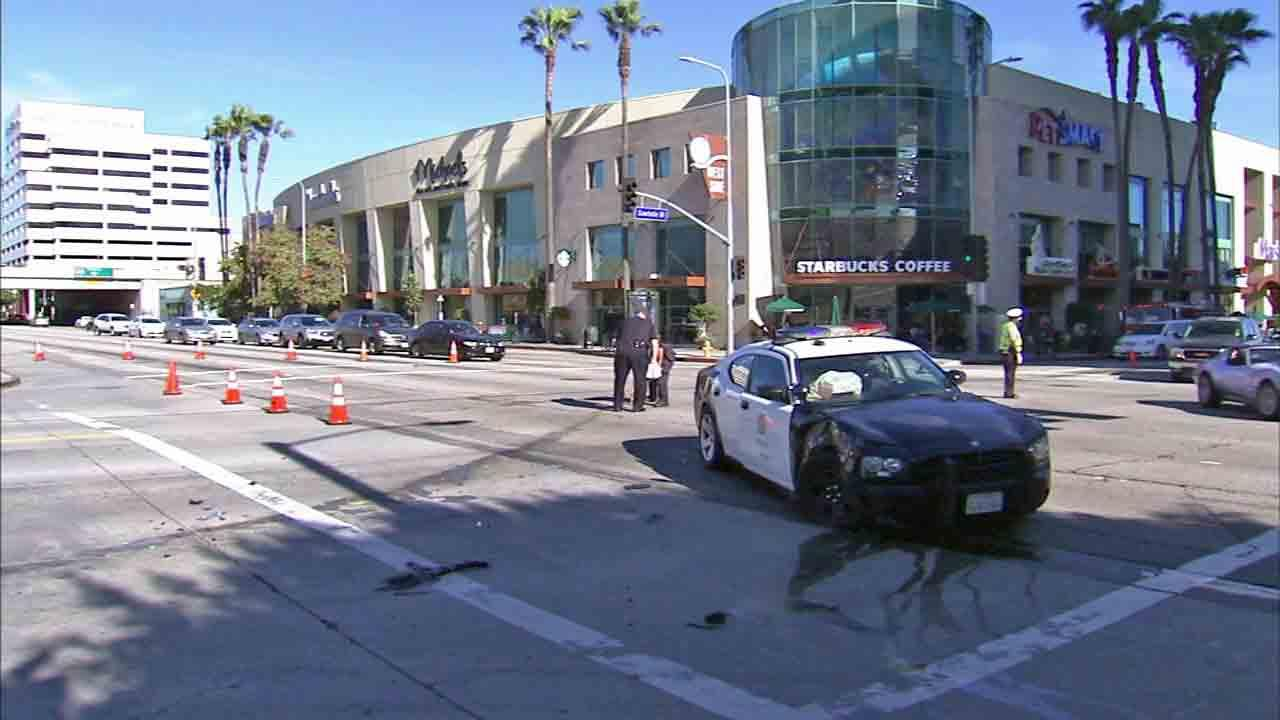 Los Angeles Police Department officers respond to the intersection of Olympic and Sawtelle boulevards in West Los Angeles after an LAPD cruiser collided with an SUV Sunday, March 9, 2014.