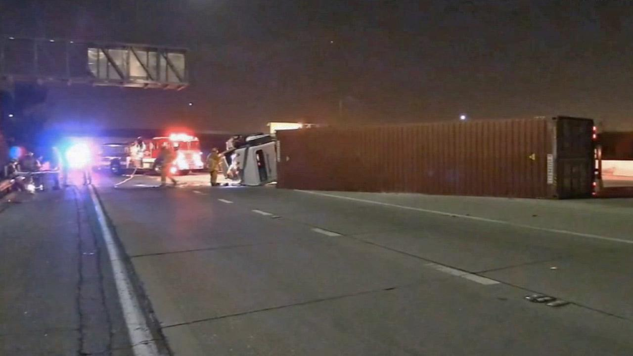 A big rig is shown on its side across multiple lanes of the 91 Freeway in Carson at South Main Street following an accident on Tuesday, March 11, 2014.