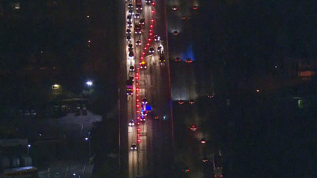 Authorities block off northbound 5 Freeway lanes after a pedestrian was struck and killed near Paramount Boulevard in the Downey area on Thursday, March 13, 2014.
