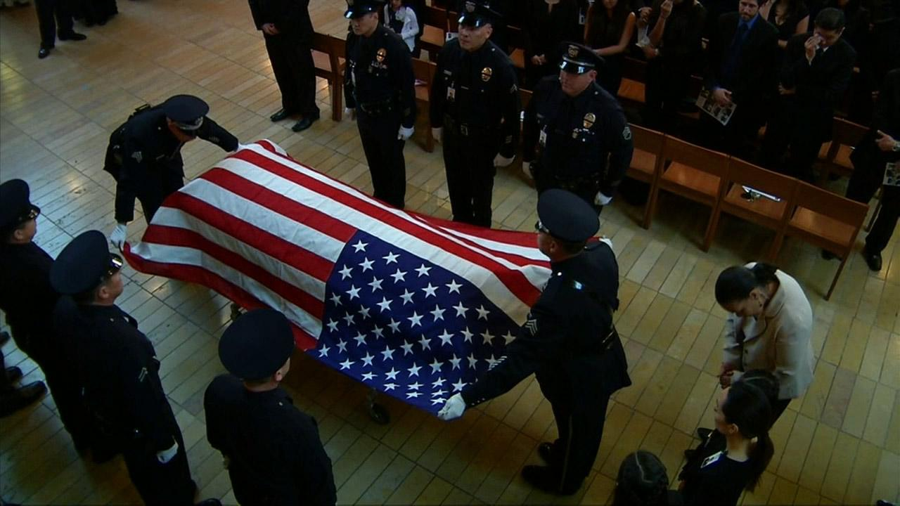 The casket of LAPD Officer Nicholas Choung Lee is seen inside the Cathedral of Our Lady of the Angels in downtown Los Angeles on Thursday, March 13, 2014.