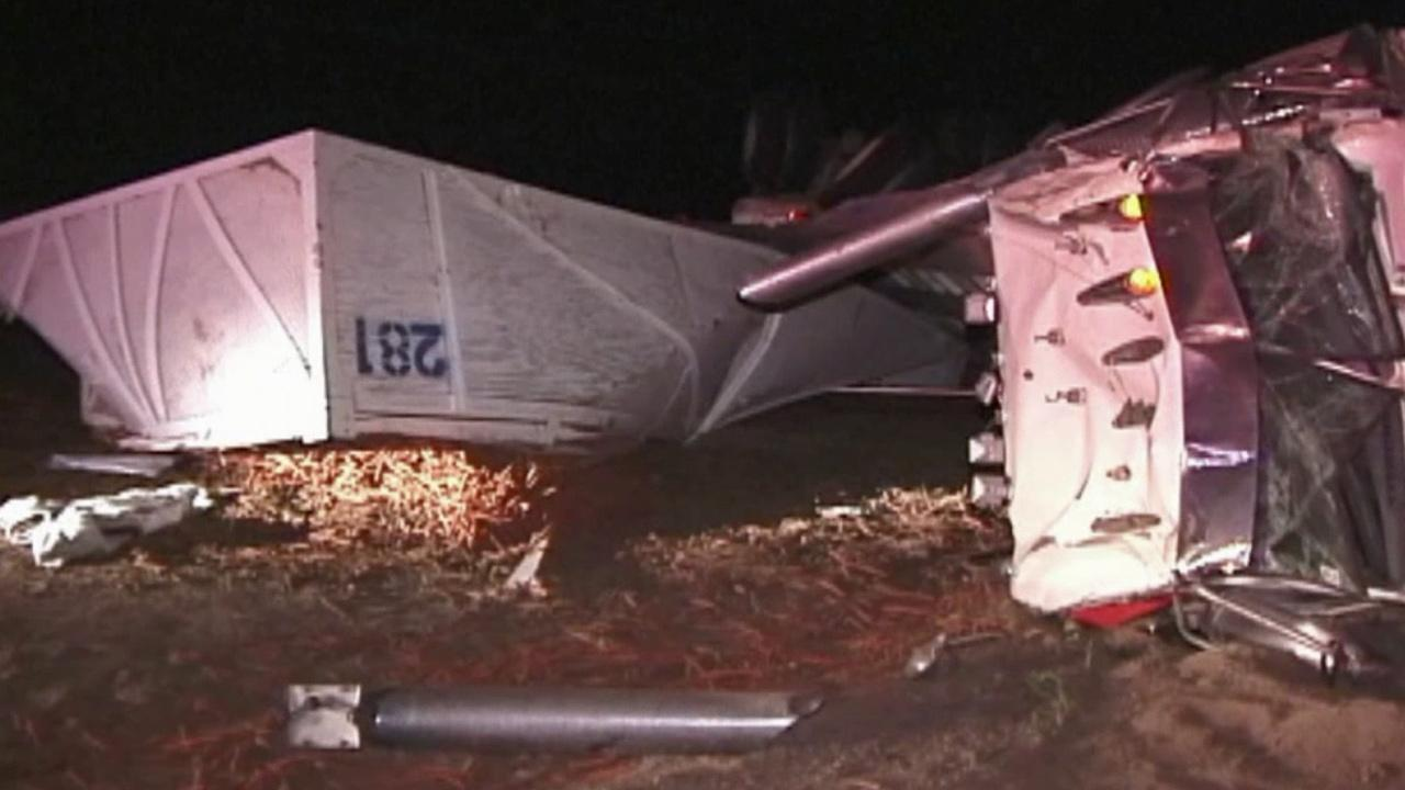 A big rig overturned in Lake Los Angeles, causing a crash and one car to get stuck in a pile of spilled carrots on Monday, March 17, 2014.