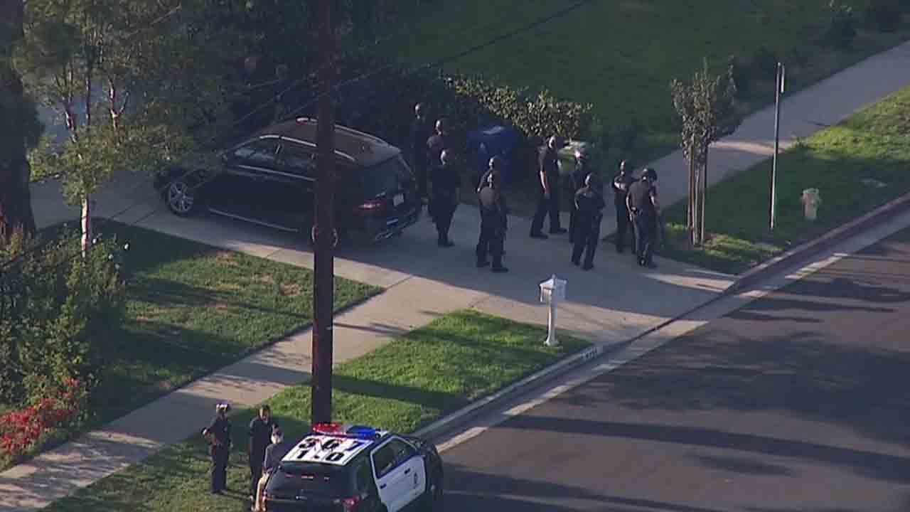 An armed man was wounded in an officer-involved shooting in the 5300 block of Mecca Avenue in Tarzana Friday, March 21, 2014.