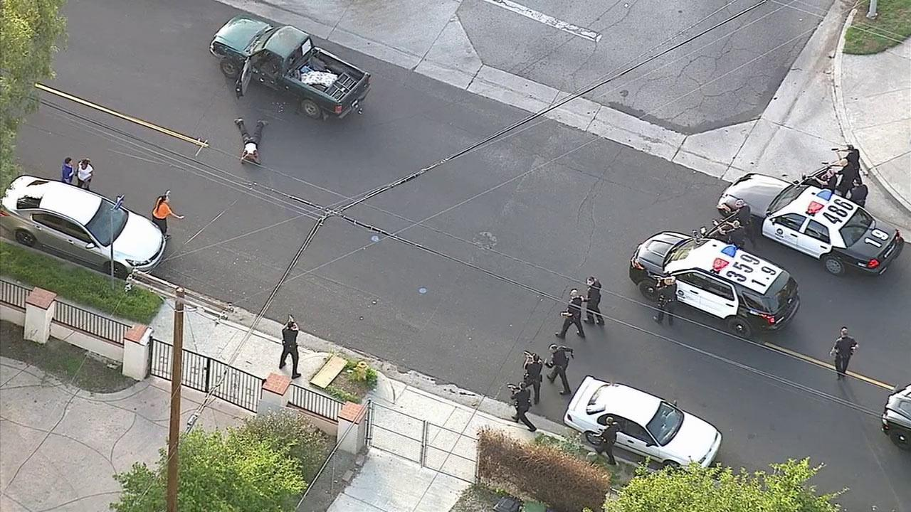 The driver of a pickup truck surrenders after leading Los Angeles police officers on a slow-speed chase through the San Fernando Valley on Friday, March 28, 2014.