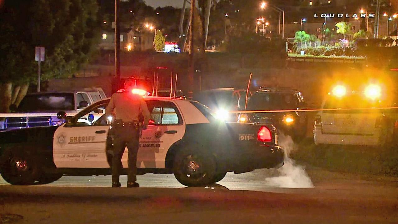 Authorities at the scene where a pedestrian was hit and killed by a Metrolink train in East L.A. on Friday, April 4, 2014.
