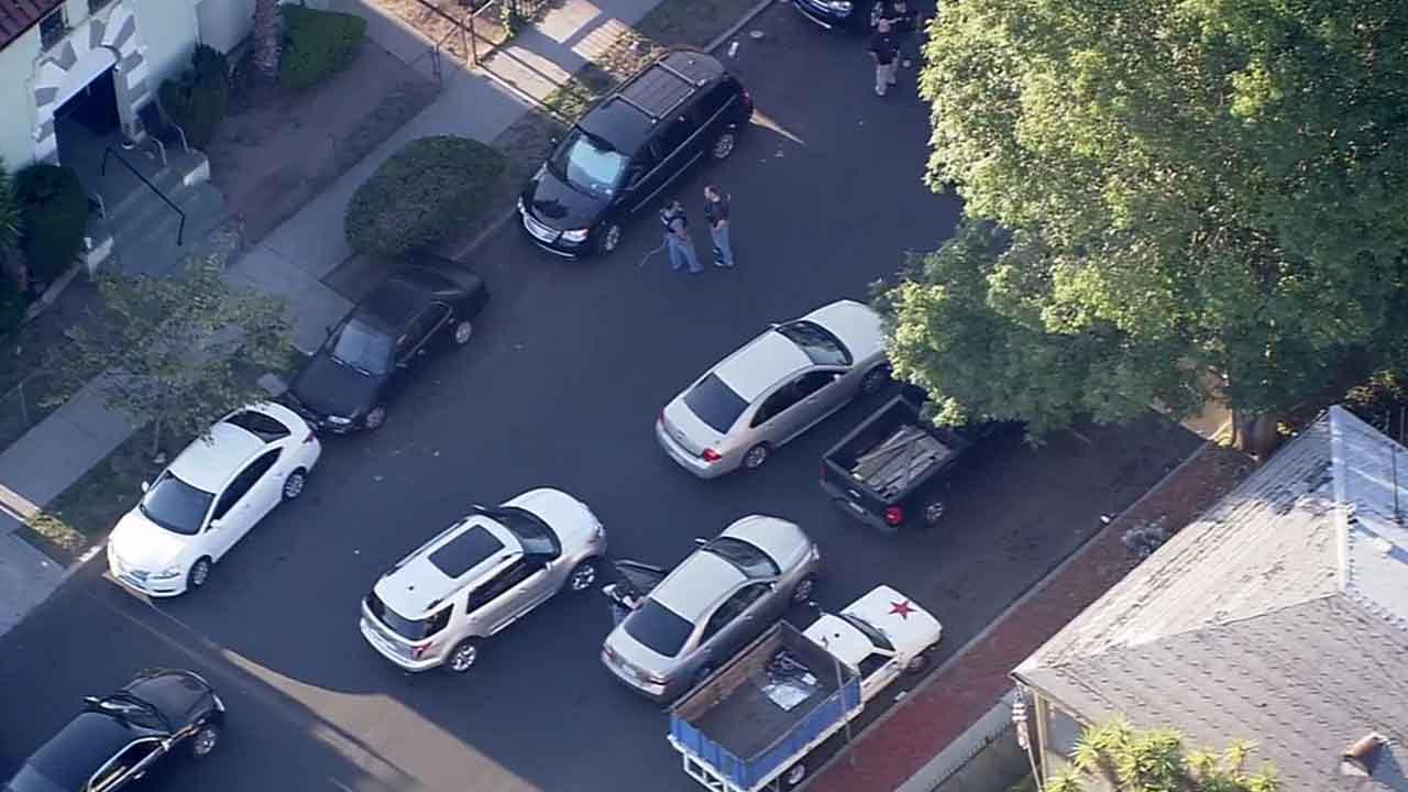 Two murder suspects were arrested by LAPD near Harvard and Adams boulevards in the Jefferson Park area of Los Angeles Tuesday, April 8, 2014.